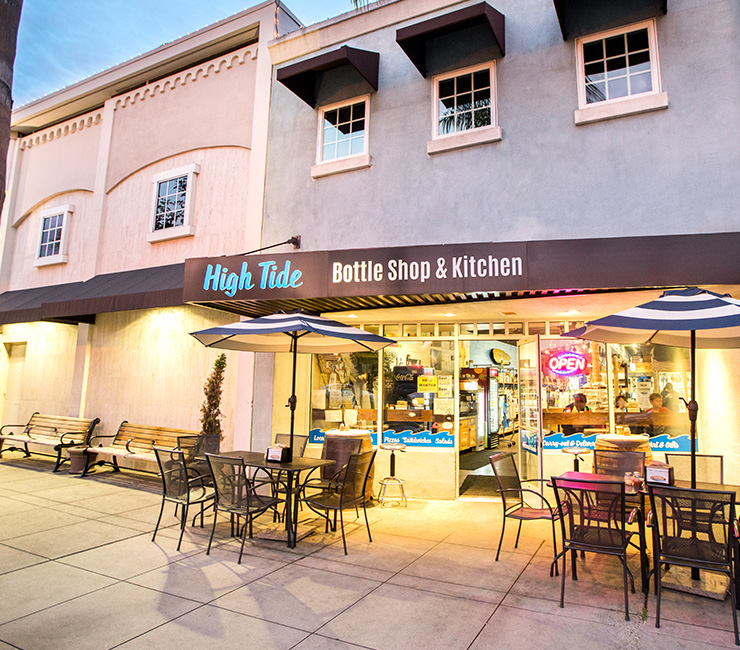 High Tide Exterior Storefront in Coronado, CA at dusk